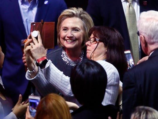 Hillary Clinton poses for a selfie at Rutgers University, after her conversation about politics, American democracy, her career and womenÕs role in the political movement at the Rutgers Athletic Center.