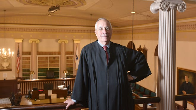 Barnstable Superior Court Judge Robert Rufo, here in the main session courtroom he has presided over for many years, spent his last official day on the job Friday and will retire next week.