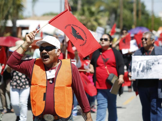 Magdaleno Castaneda shouts during a march from the historic site of Cesar Chavez's march in '66 with hundreds of United Farm Worker members and supporters to protest Donald Trump and celebrate the March 31st birthday of Chavez, the UFW founder, on Sunday in Delano. Calif. The march started at Our Lady of Guadalupe Church and ended at Cesar Chavez Park.