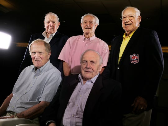 Members of the 1957 Lions championship team,  back row L to R: Bud Erickson, Gene Cronin, Roger Zatkoff, front row: Steve Junker and Joe Schmidt, photographed in Bloomfield Township on July 26, 2017.