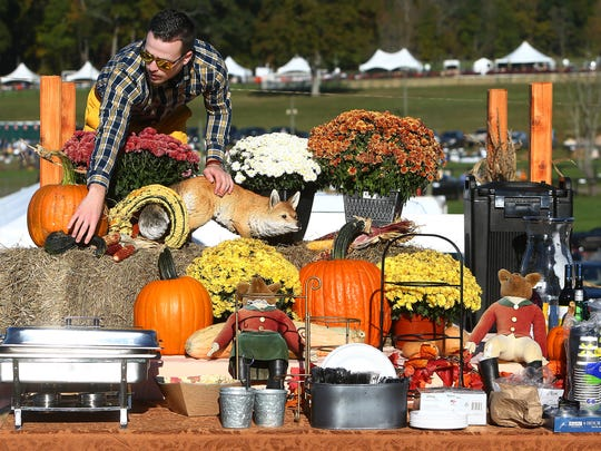 Derek Mikitik of Hopatcong arranges a display on his tailgate during the 97th running of the Far Hills Race Meeting at Moorland Farms. October 21, 2017. Far Hills, New Jersey
