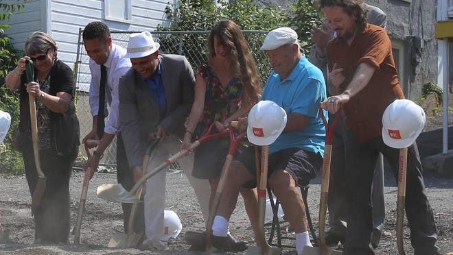 Planning and Development Director JoAnn Cornish, Mayor Svante Myrick, Josh Lower (joined by his wife and father) and Greenstar General Manager Brandon Kane break ground at 307 College Ave. Monday.