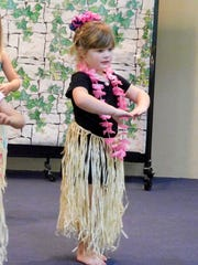 The hukilau consists of basic hula steps and arm movements