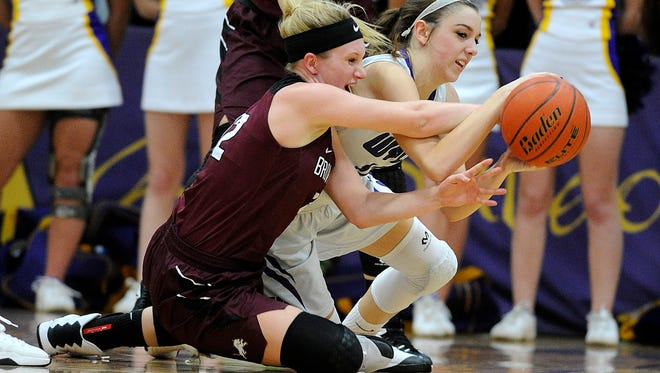 Brownwood's Sage Cupps (left) fights for a loose ball with Wylie's Claire Allen (right) during the second quarter of Brownwood's 50-45 win Tuesday, Jan. 24, 2017, at Wylie High School.