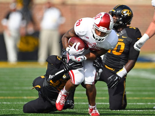 Indiana Hoosiers running back D'Angelo Roberts (20) runs the ball against the Missouri Tigers during the first half at Faurot Field.