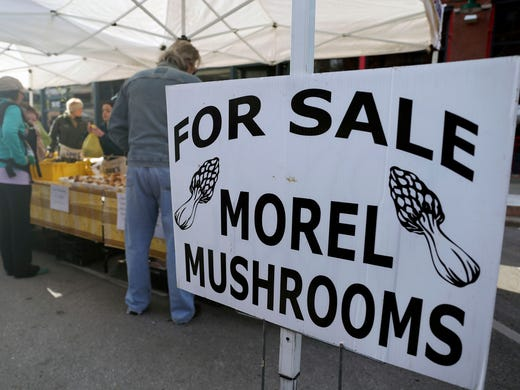 A sign advertises the sale of early-season morel mushrooms at opening day of the Downtown Farmer's Market on Saturday, May 3, 2014, in downtown Des Moines, Iowa.