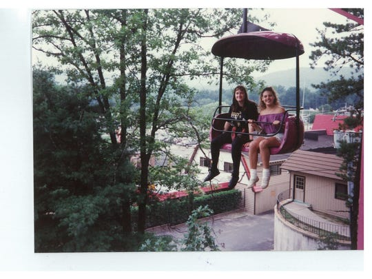Celeste Murillo, teen dressed in black, spent a year and half with Robert Honsch, the man she believed to her father, and his daughter, Elizabeth Honsch, other teen in photo. The trio would often go on trips together. Photo was taken from one of their trips during 1991-1992.