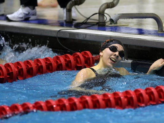 Niki Price reacts after swimming to gold at the District 3 championships ... GameTimePA.com.