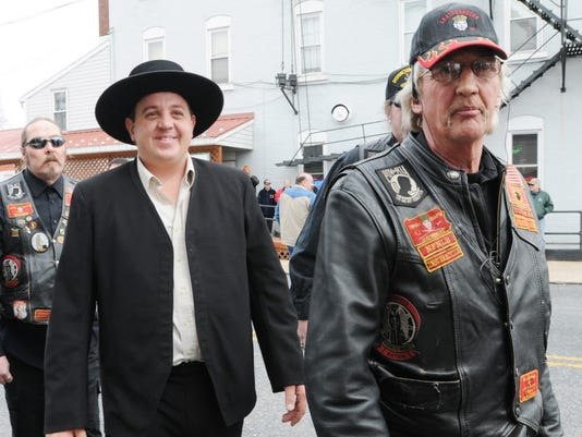 """Lebanon Levi, the enforcer in Discovery Channel's """"Amish Mafia"""" is escorted by members of the Leathernecks Motorcycle Club at an event to benefit  Fredericksburg's Matthews Public Library in March 2013."""