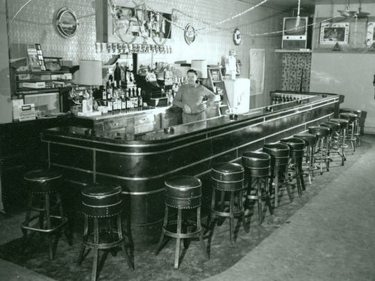 This interior image of the bar was taken in August of 1961. Joe Dreps is the bartender. Dreps Bar, 702 Center Avenue.