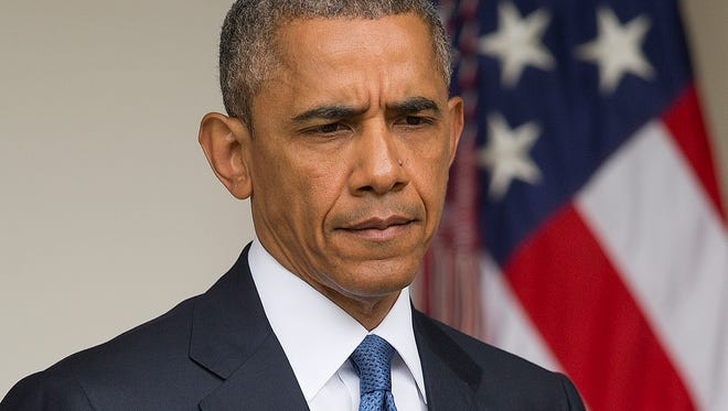 President Obama walks toward the podium before speaking in the Rose Garden of the White House on June 26.