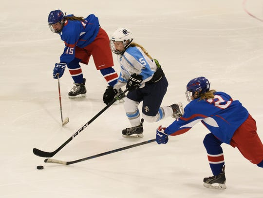 South Burlington's Lilly Truchon (5) skates between