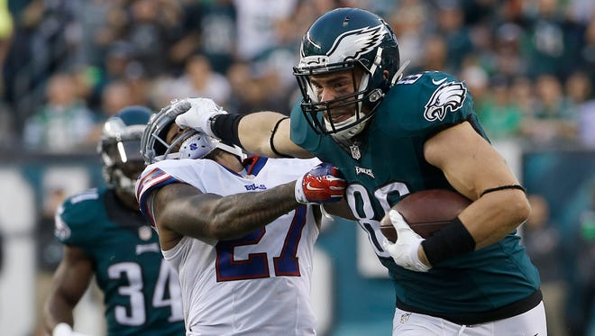 Philadelphia Eagles' Zach Ertz, right, breaks a tackle attempt by Buffalo Bills' Duke Williams during the second half of an NFL football game, Sunday, Dec. 13, 2015, in Philadelphia. (AP Photo/Michael Perez)
