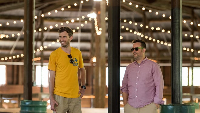 """Alan Weeth, Analog-A-Go-Go director, and Neal Stewart, Dogfish Head's  vice president of marketing, speak about this weekend's festival in the Figure-8 Barn at Bellevue State Park. The barn will host the """"Best Firkin Friends Beer Festival"""" within the Analog fest Saturday."""