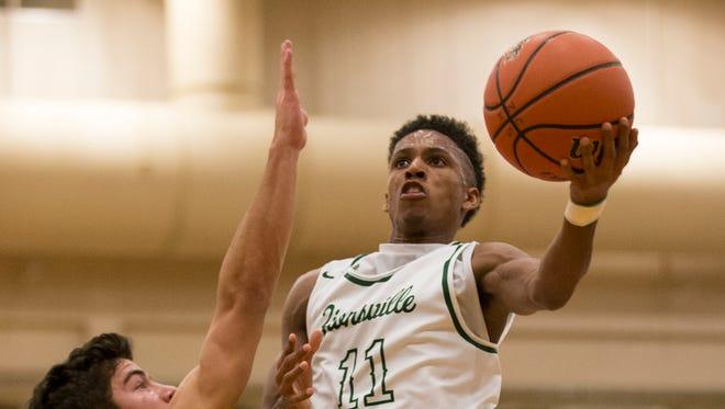 Isaiah Thompson of Zionsville High School, puts up a shot on Luke Heady of Carmel High School, Carmel at Zionsville boys basketball, Zionsville, Tuesday, Nov. 21, 2017. Zionsville won 68-62.