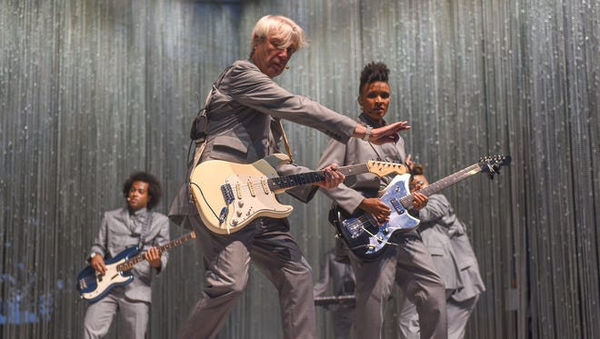 David Byrne, center, performs Saturday at the Farm Bureau Insurance Lawn at White River State Park. At left is bass player and Indiana University alum Bobby Wooten. At right is guitarist Angie Swan.