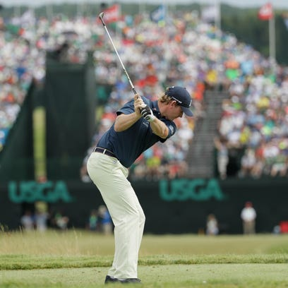 Brandt Snedeker hits a tee shot on the ninth hole during