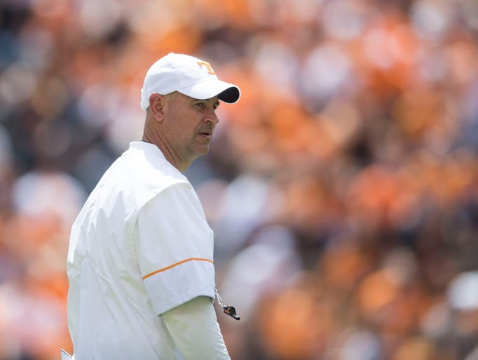 Coach Jeremy Pruitt walks on the field during the Tennessee