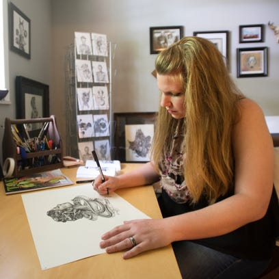 Jennifer Janeiro, owner of Bone and Ink, works on an ink drawing in a studio at her home in Pendleton on Wednesday, May 11, 2016. Janeiro will be participating in Artisphere for the first time this year.