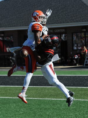 North Greenville cornerback Rochar Witherspoon, right, breaks up a pass intended for Carson-Newman wide receiver Aaron Seward on Saturday at Younts Stadium in Tigerville, S.C.