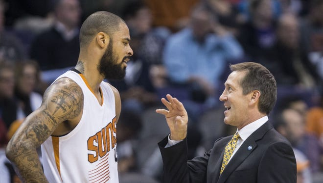 Suns head coach Jeff Hornacek talks to Tyson Chandler during a timeout at Talking Stick Arena on Dec. 13, 2015 in Phoenix, Ariz.