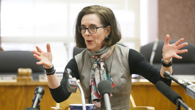 """Gov. Kate Brown talks about the recent departure of several of her staff members, wishing them well and that they """"fly away,"""" at a media panel on Thursday, Jan. 26, 2017, about plans for the upcoming legislative season."""