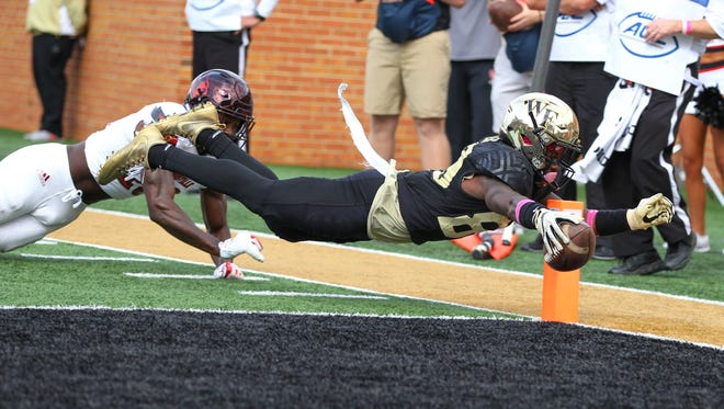 Wake Forest wide receiver Greg Dortch dives for a touchdown in the second quarter against the Louisville Cardinals at BB&T Field.