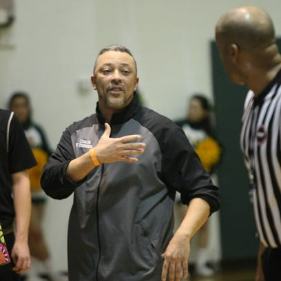 Northwest coach Vincent Turner talks with a referee
