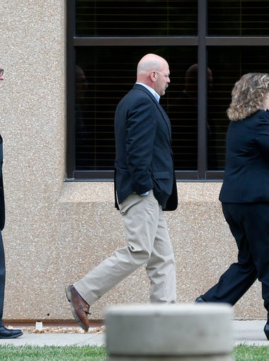 Joey Kyle (center) walks in the the Federal Courthouse on Wednesday, May 20, 2015.