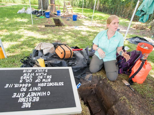 University of West Florida archaeology student Brianna Patterson discusses the excavation at Chimney Park in Pensacola on Tuesday, July 3, 2018.