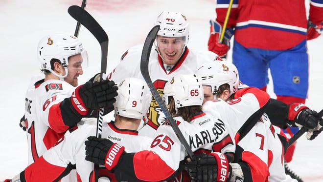 Ottawa Senators defenseman Erik Karlsson (65)  celebrates his goal against the Montreal Canadiens with teammates during the second period in Game 5 of the first round of the 2015 Stanley Cup Playoffs at Bell Centre.
