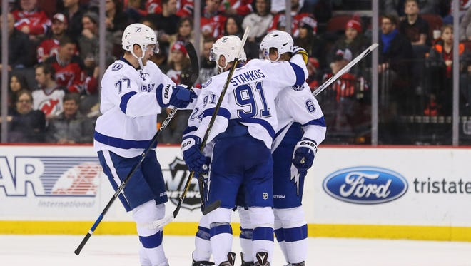The Tampa Bay Lightning celebrate a goal by Tampa Bay Lightning center Steven Stamkos (91) during the second period at Prudential Center.