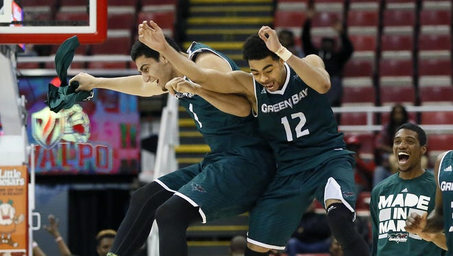 Duane Burleson/AP UWGB's Kerem Kanter (1) and Carrington Love (12) celebrate after a 99-92 overtime win against Valparaiso during the Horizon League tournament at Joe Louis Arena. Green Bay's Kerem Kanter (1) and Carrington Love (12) celebrate after a 99-92 overtime win against Valparaiso during a NCAA college basketball game in the Horizon League tournament Monday, March 7, 2016, in Detroit. (AP Photo/Duane Burleson)