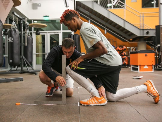 Tennessee Volunteers Director of Sports Medicine Jason McVeigh works with defensive back Justin Martin #8 of the Tennessee Volunteers on April 19, 2016. Photo By Donald Page/Tennessee Athletics