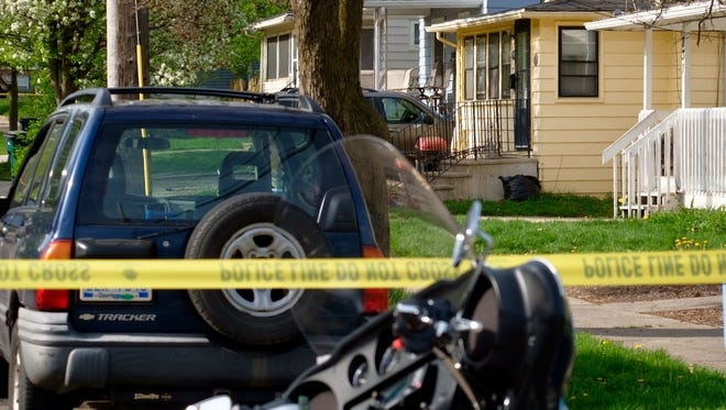 Police blocked the 700 block of Cleveland Street in Lansing due to a shooting Wednesday, May 9, 2018. Police believe the shooting happened at the yellow house.