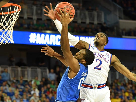 Kansas Jayhawks guard Lagerald Vick (2) blocks the shot of Seton Hall Pirates guard Khadeen Carrington (0) in the first half in the second round of the 2018 NCAA Tournament