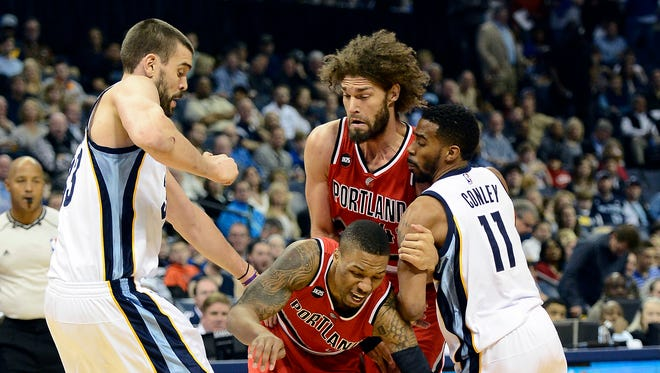 Portland Trail Blazers guard Damian Lillard (0) drives past  Memphis Grizzlies center Marc Gasol, left, as center Robin Lopez, top center, sets a pick on guard Mike Conley (11) in the first half of an NBA basketball game Saturday, March 21, 2015, in Memphis, Tenn.