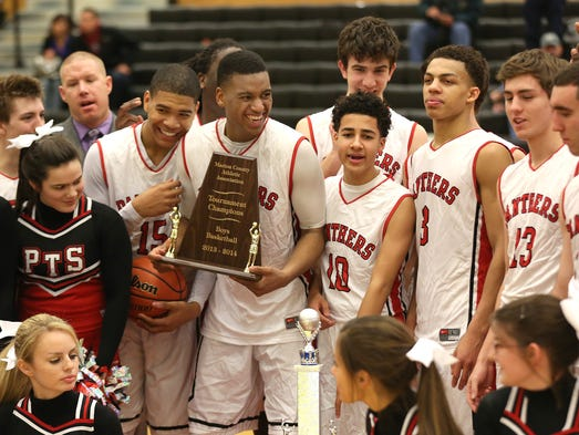 Park Tudor players celebrate their win against Warren Central during the Marion County Boys basketball tournament at Warren Central Saturday January 18, 2014. Park Tudor won 65-51.
