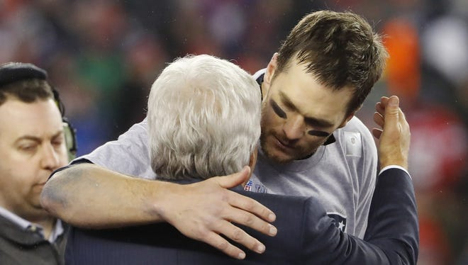 New England Patriots owner Robert Kraft hugs quarterback Tom Brady after defeating the Pittsburgh Steelers in the 2017 AFC Championship Game at Gillette Stadium.