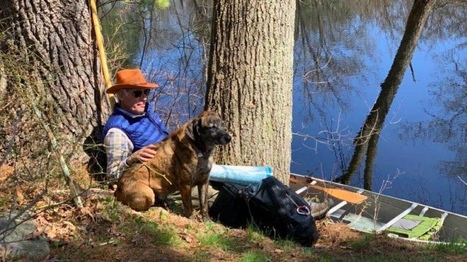 Dave Comb, of Manchester, enjoys a paddle with dog Kip while raising funds to support Ipswich River Watershed Association's Clean Water Program. Dave and Kip have participated in Paddle-a-thon all five years.