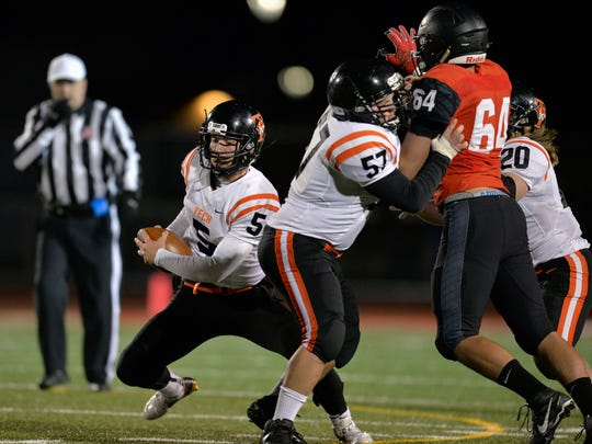 St. Cloud Tech quarterback Chris Backes (5) finds a