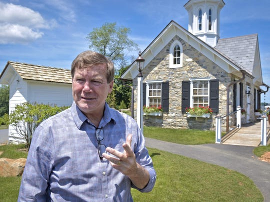In this June 25, 2018, photo owner David Abel speaks in front of The Star Barn in Elizabethtown, Pa. A county tourism group will hold a meeting at a historic venue in Pennsylvania Dutch Country despite a recent outcry over the locale's ban on same-sex weddings. The policy at The Star Barn, a top wedding spot in Elizabethtown that is surrounded by farmland, orchards and vineyards in scenic Lancaster County, drew the attention last month of a retired teacher who was attending an event there. (Dan Marschka/LNP/LancasterOnline via AP)