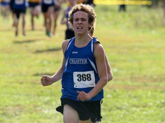 Nick Monroe of the charter school of Wilmington completes the boys Junior varsity 5K cross country run during the Joe O'Neill Invitational Meet on Friday at Bellevue State Park in Wilmington.