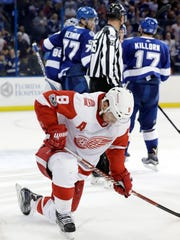 Red Wings left wing Justin Abdelkader (8) reacts as the Lightning celebrate after the Wings' 3-2 loss on Thursday, Oct. 26, 2017, in Tampa, Fla.