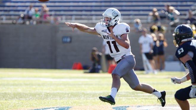 Montana quarterback Chad Chalich (11) scrambles to get the ball away against UC Davis last week in California.