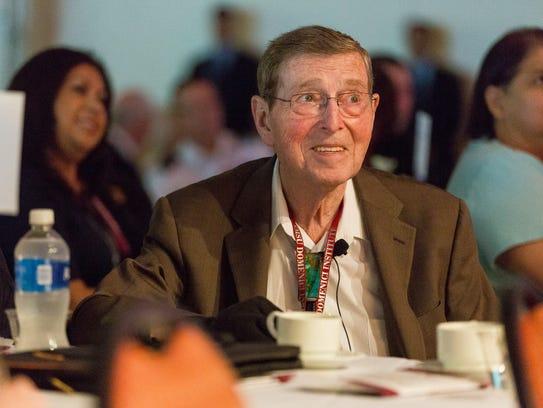 Former Sen. Pete Domenici attends his signature Domenici