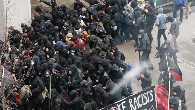 Police use pepper spray on protesters in Washington, D.C., on President Trump's inauguration day. The chaotic confrontation occurred just blocks from Trump's inauguration festivities.