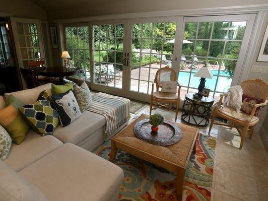 The family added a four-season room to enjoy the gardens