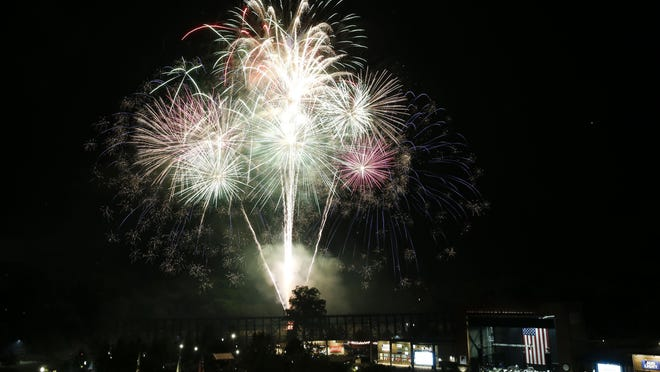 Fireworks burst over the Tuscaloosa waterfront during the Celebration on the River Wednesday, July 4, 2018.