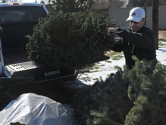 In this file photo, Michael Cox drops off his natural Christmas tree at Kiwanis Park on Southwest Parkway. Wichita Falls residents can drop their natural Christmas trees at four locations, including Kiwanis, Lucy Park, City Landfill, City Transfer Station. The program runs through Jan. 15. Tree disposal is free for city residents.